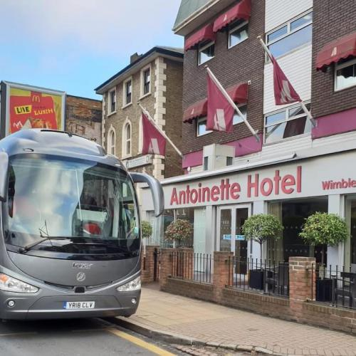 Airport transfer by coach to Antoinette Hotel, Wimbledon, London